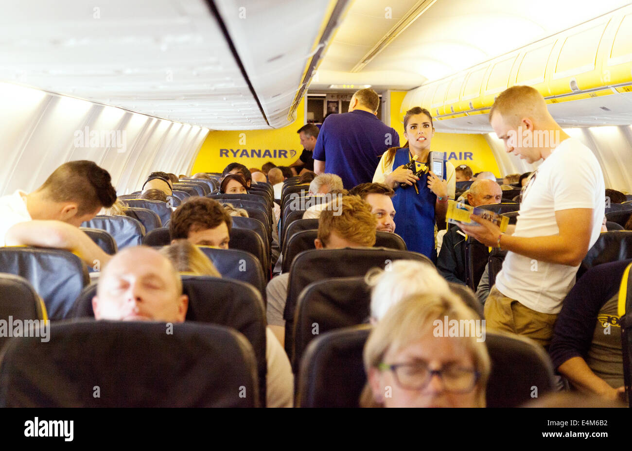 Passengers and staff in the plane cabin, Ryanair low cost airline - Stock Image