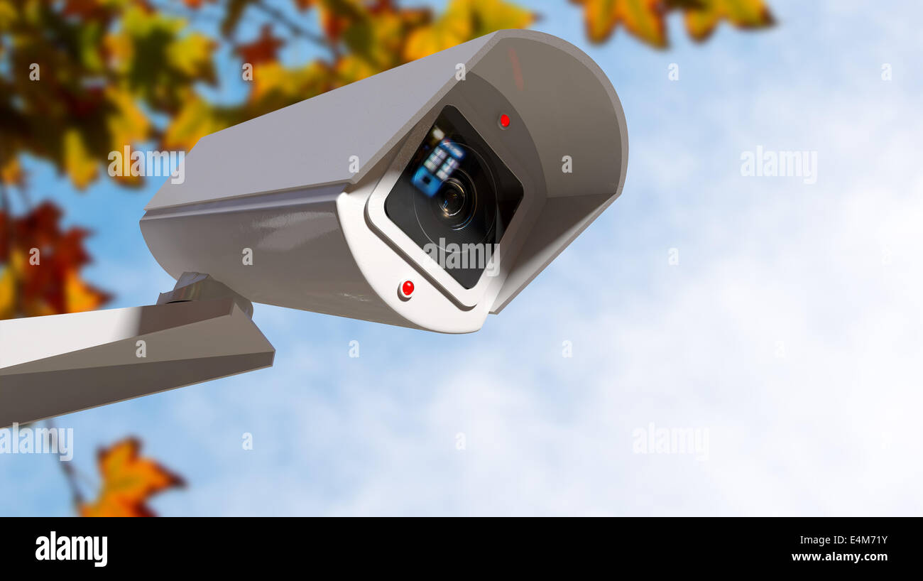 A white wireless surveillance camera with illuminated lights mounted on a wall in the daytime with copy space - Stock Image