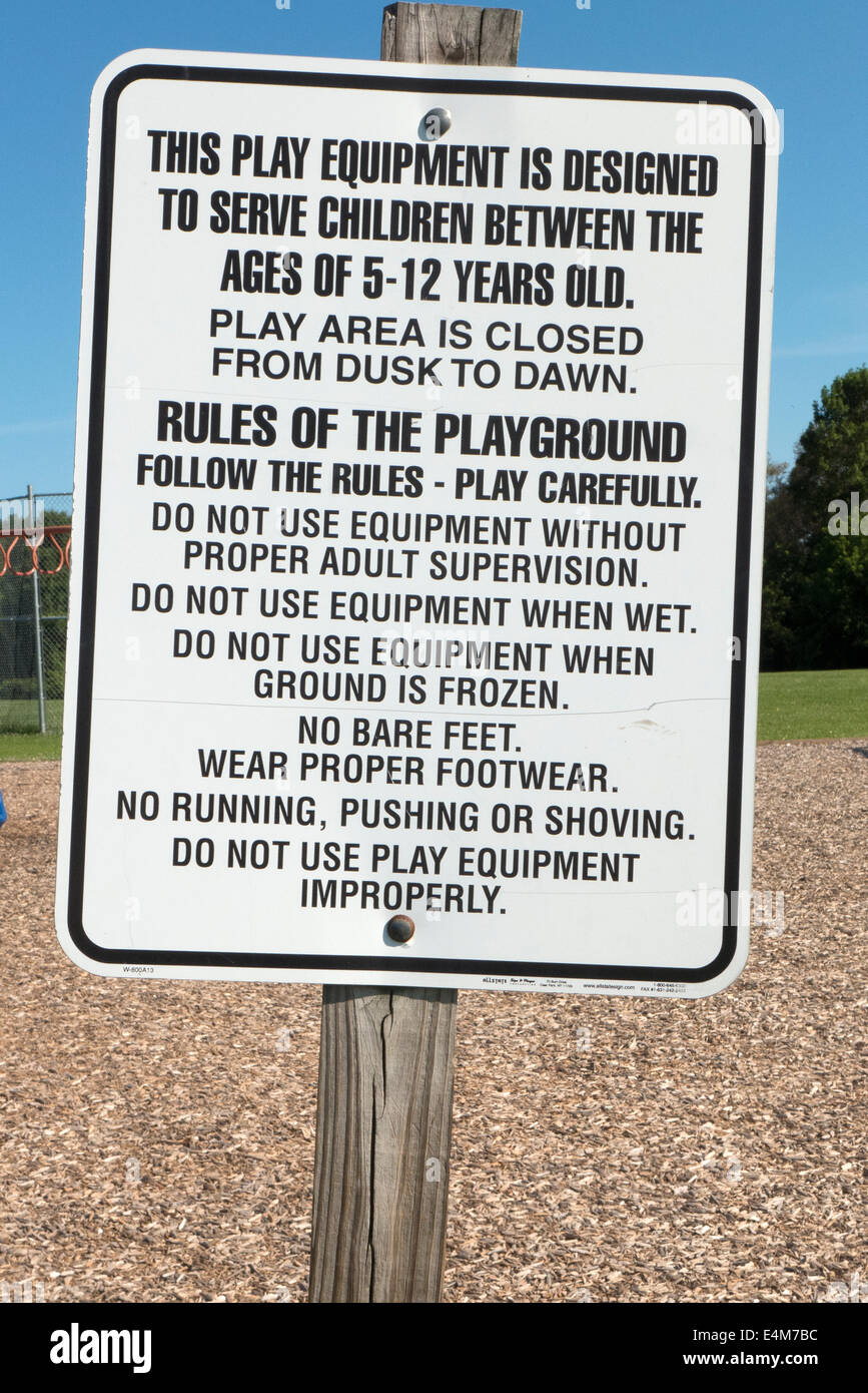 Sign for playground usage. - Stock Image