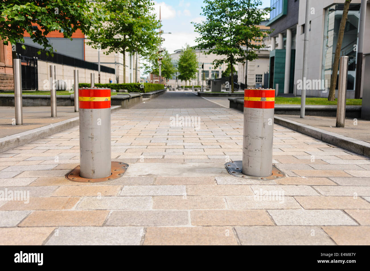 Hydraulically operated high security rising bollards preventing vehicles proceeding down a pedestrian area without - Stock Image