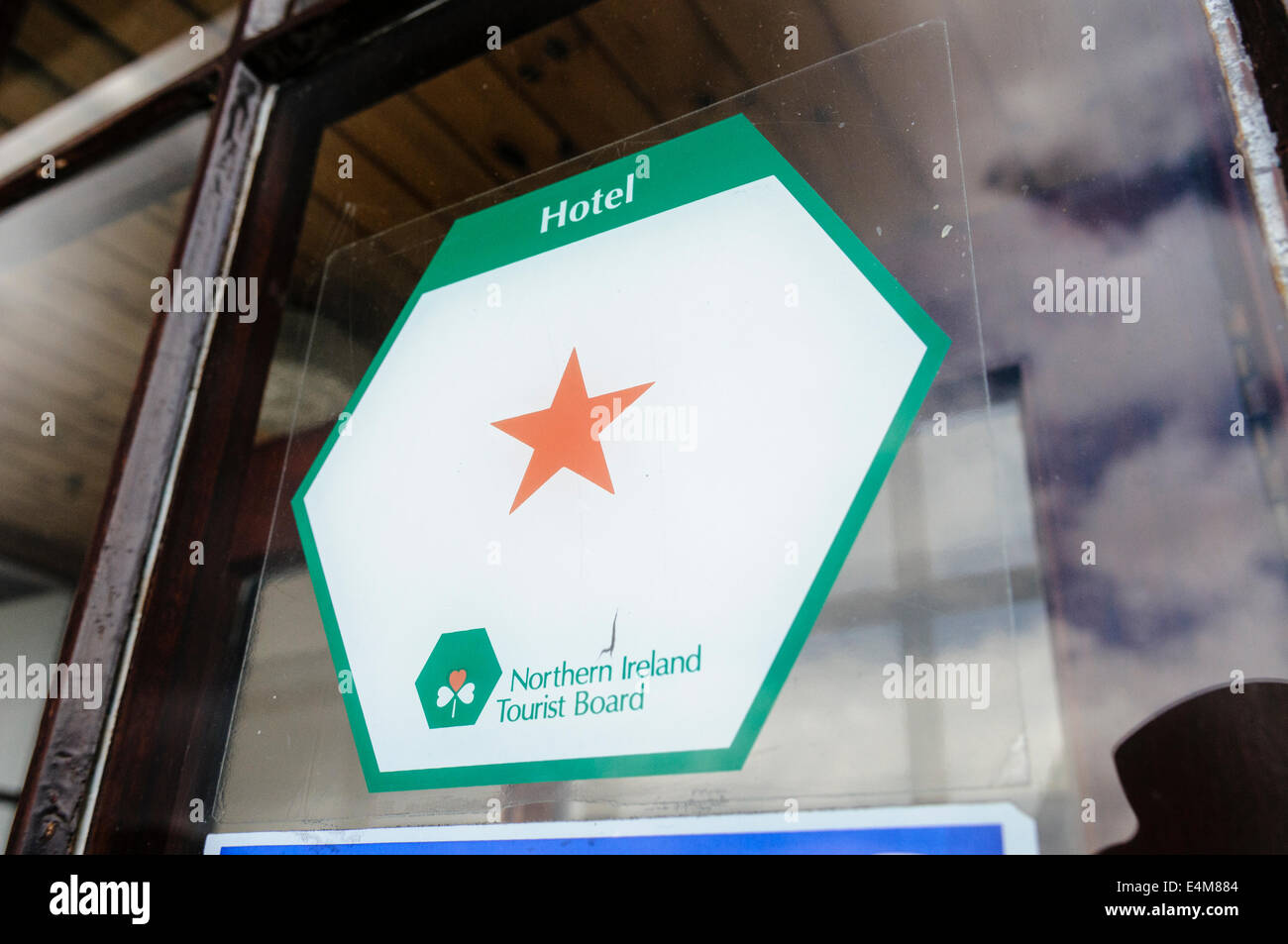 sign on a hotel showing it has been awarded one star rating by the Northern Ireland Tourist Board - Stock Image