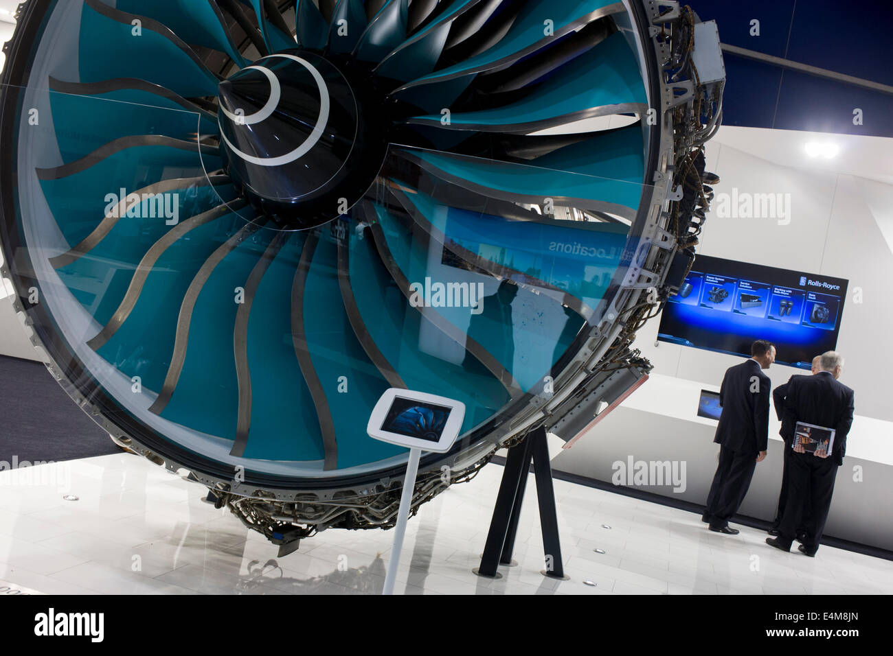 A full-size Trent jet engine is admired by delegates visiting British Rolls-Royce manufacturer's exhibition - Stock Image