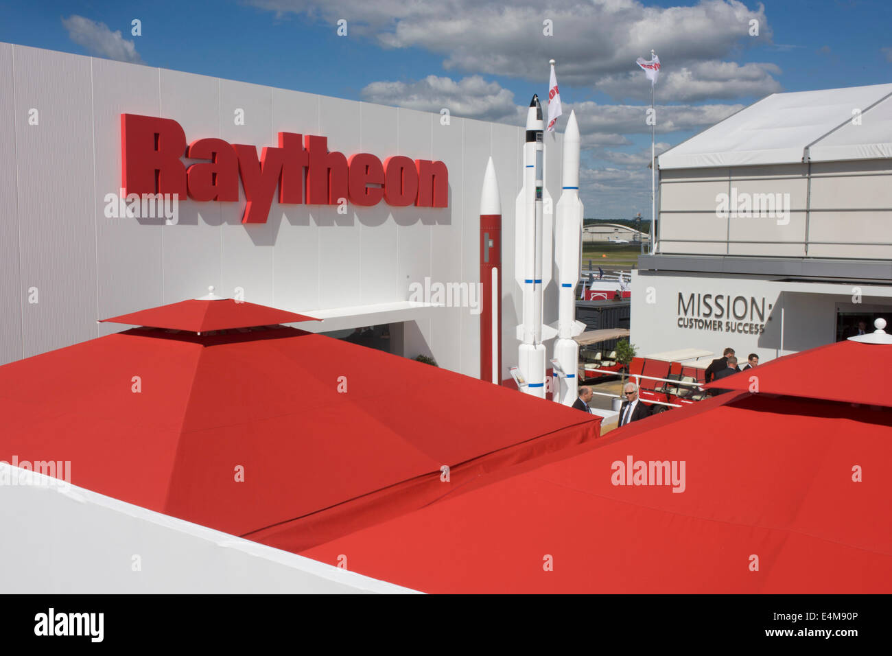 Defence manufacturer Raytheon exhibition stand at the Farnborough Air Show, England. Raytheon Company is a technology - Stock Image