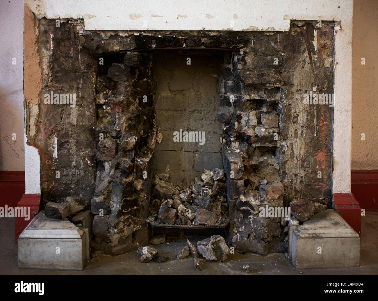 A fireplace with the original fire surround removed - Stock Image