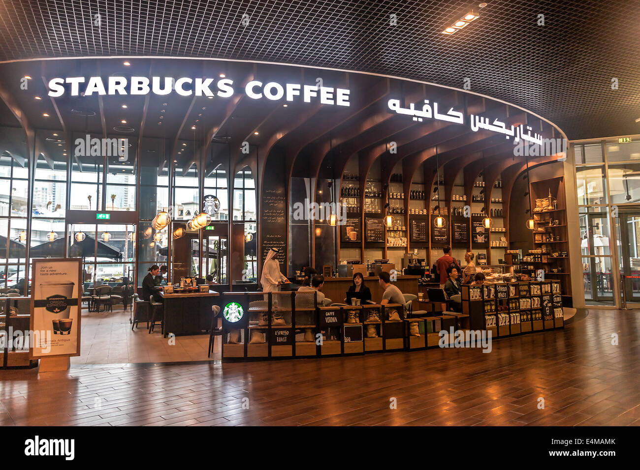 dd3e20deb Starbucks coffee shop with local man in traditional Arab dress in the Dubai  Mall