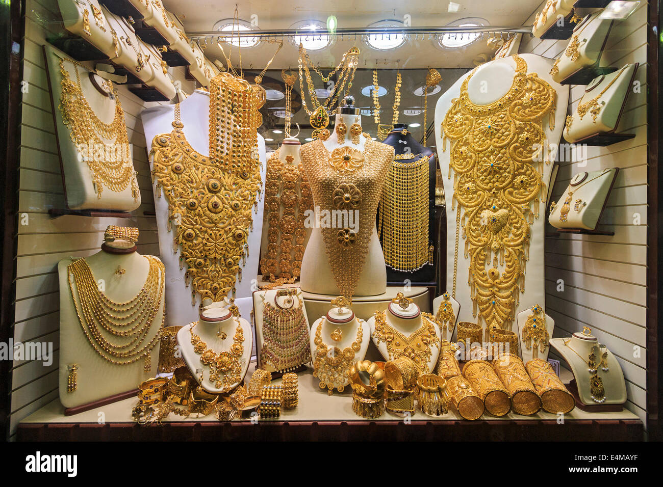 Gold jewelry in Dubai's gold souk. The gold souk consists of over 300 retailers that trade almost exclusively - Stock Image