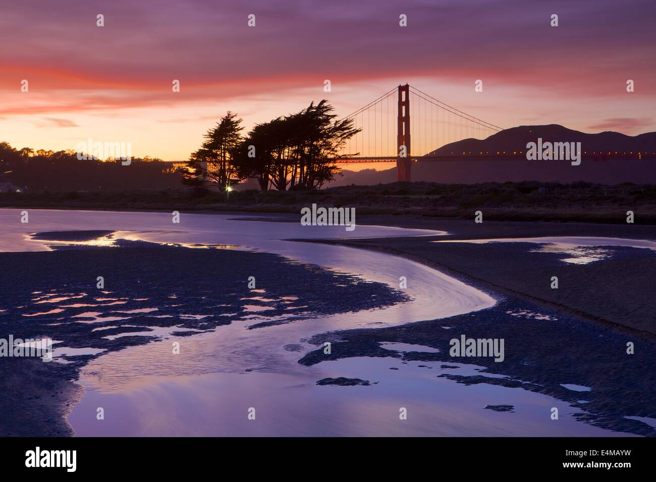 Beautiful sunset at Crissy Lagoon with the Golden Gate Bridge in the background - Stock Image