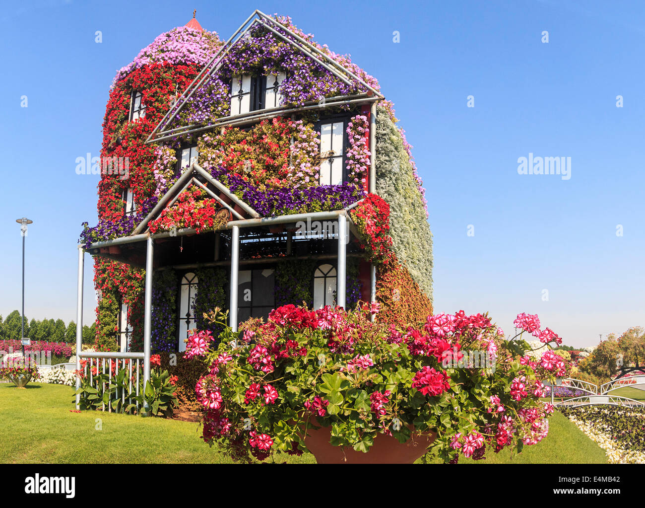 House covered in flowers at Dubai's Miracle Garden, largest