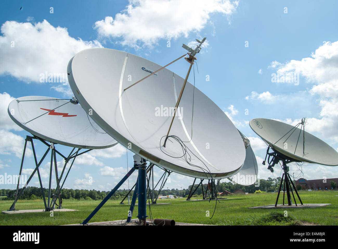 Array of satellite receiver dishes - Stock Image