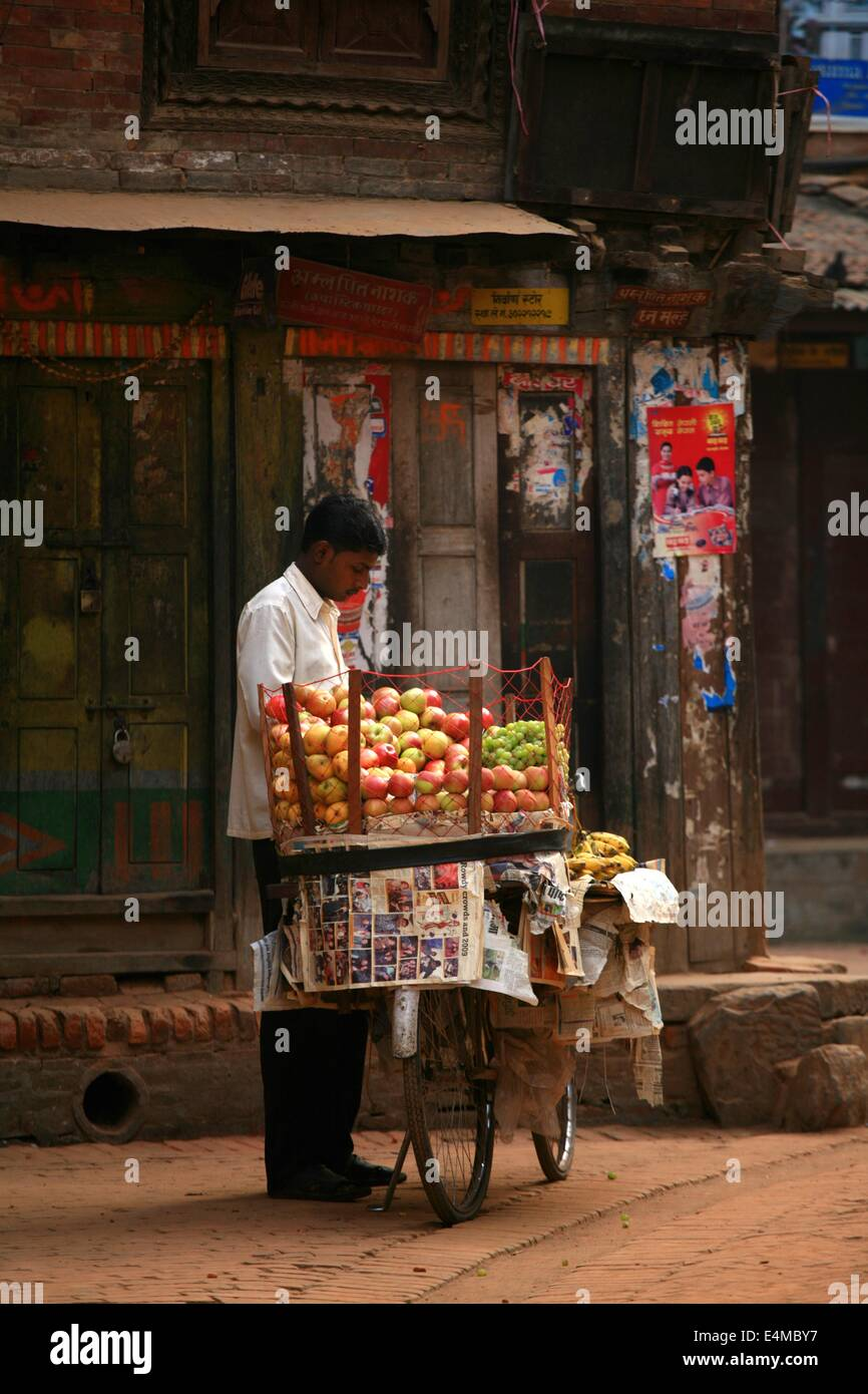 A man sells produce from a cart in Kathmandu, Nepal - Stock Image
