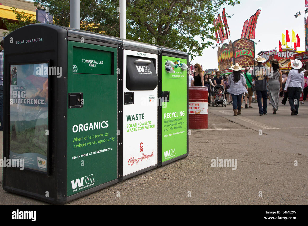Recycle, waste and organics disposal bins on Calgary Stampede Grounds. Stock Photo