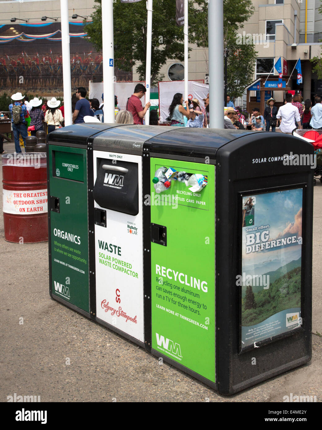 Recycle, waste and organics disposal bins on Calgary Stampede Grounds. - Stock Image