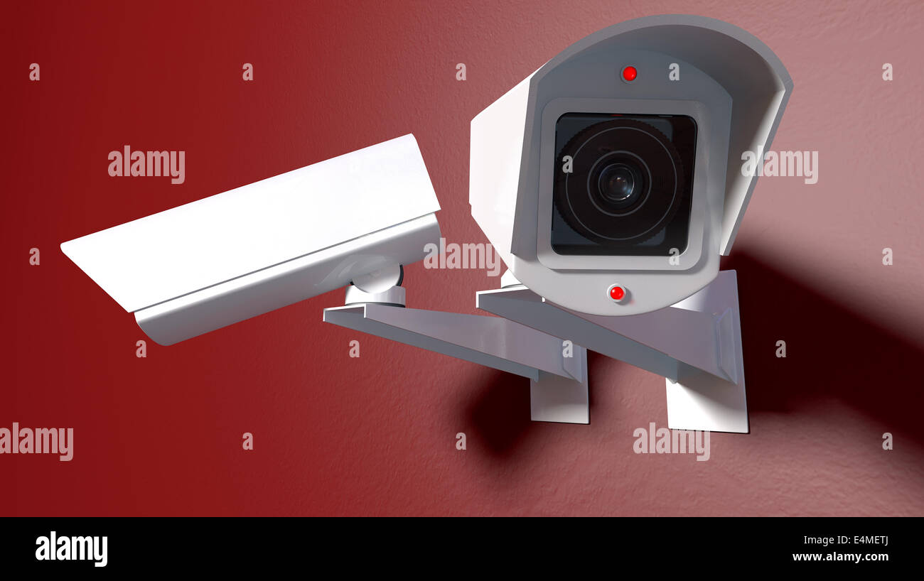 Two white wireless surveillance camera with illuminated lights mounted on an isolated red wall with copy space - Stock Image