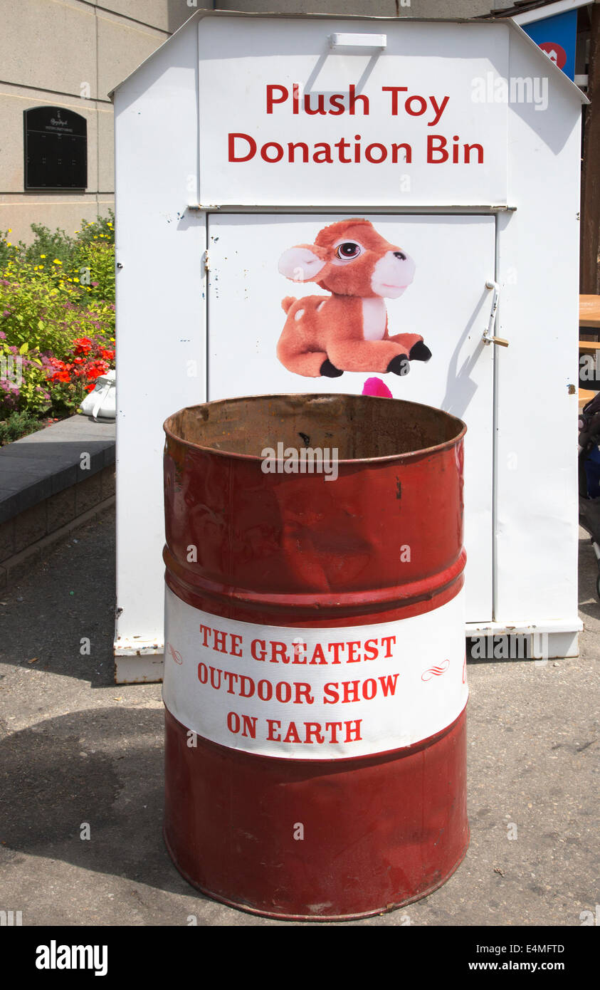 Plush Toy Donation Bin and trash can at the Calgary Stampede - Stock Image
