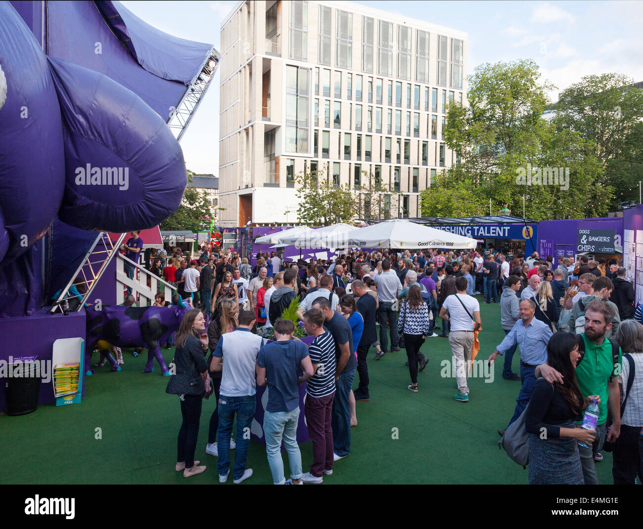 The Pasture, an outdoor eating and drinking venue adjacent to the Udderbelly purple tent cow during Edinburgh Festival - Stock Image