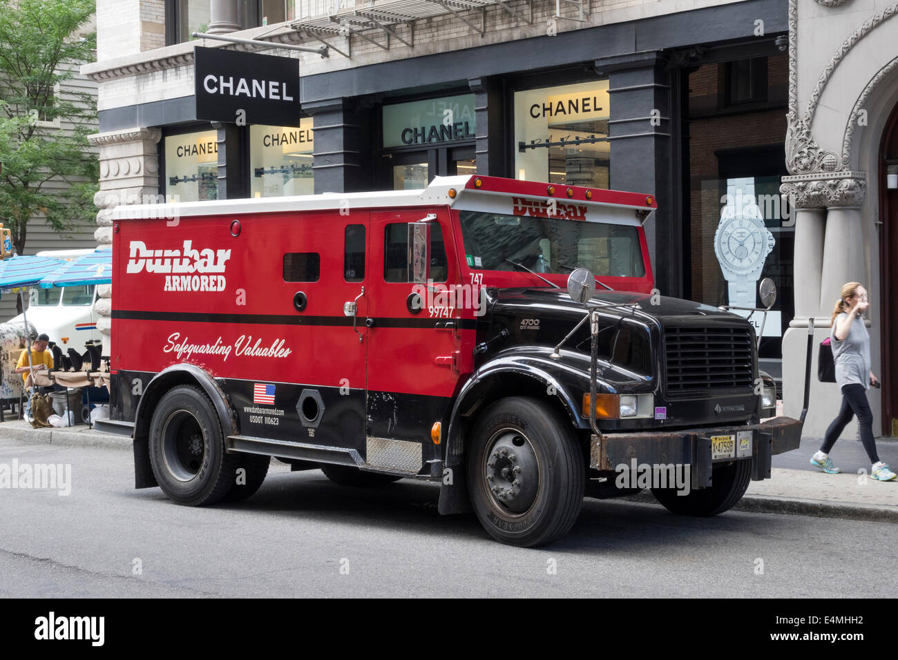 Armored car picking up money from a Chanel shop in Soho in New York City - Stock Image