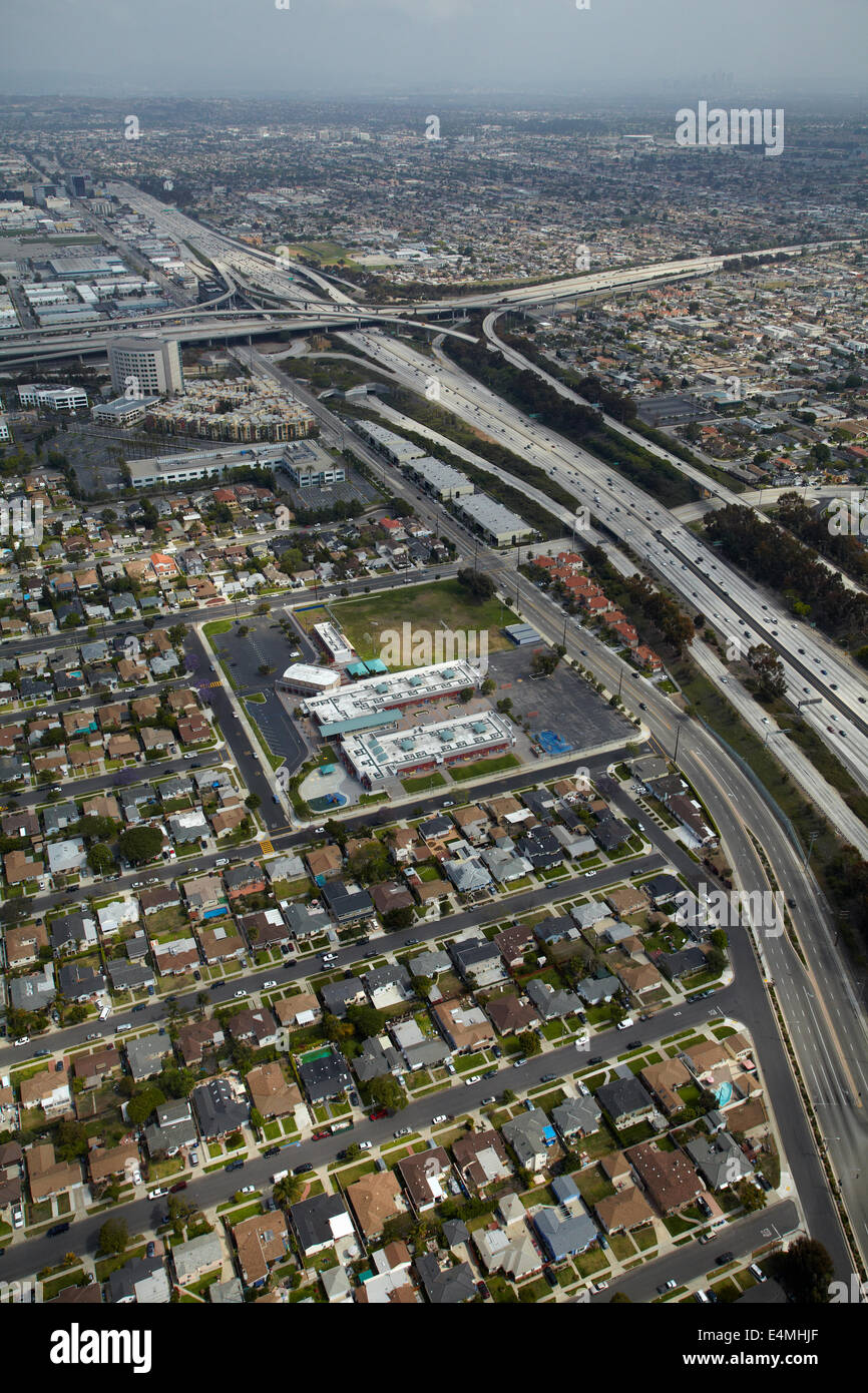 Interstate 405 near LAX, and interchange with I-105 in distance, Hawthorne, Los Angeles, California, USA - aerial - Stock Image