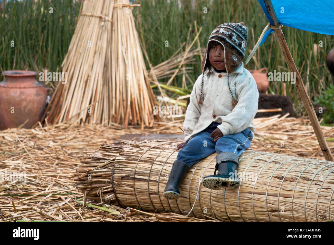 Lake Titicaca, shared by Peru and Bolivia, is the cradle of ancient ethnic and indigenous groups that inhabit the - Stock Image