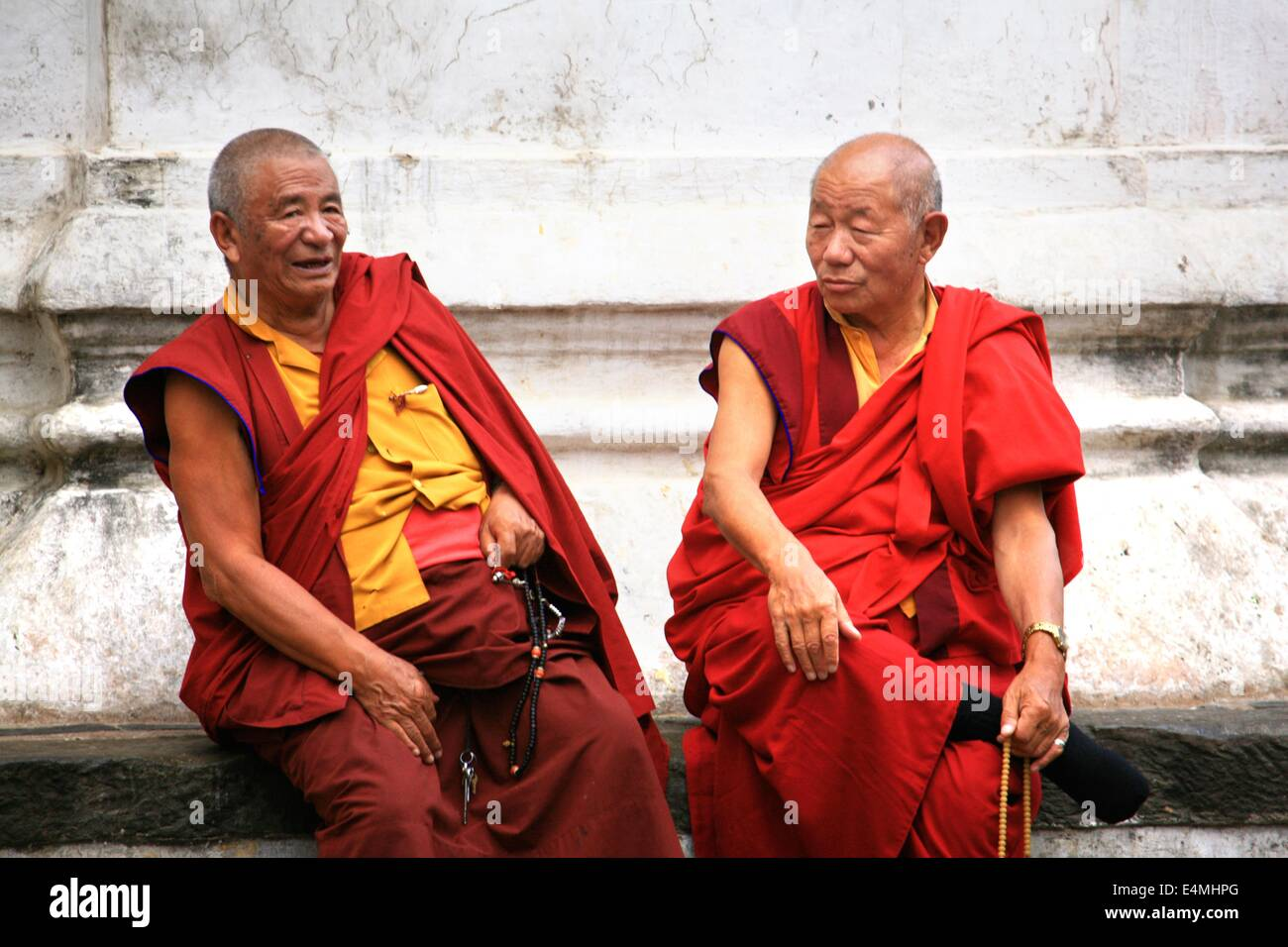 Tibetan buddhist monks chat and laugh at a temple in ...