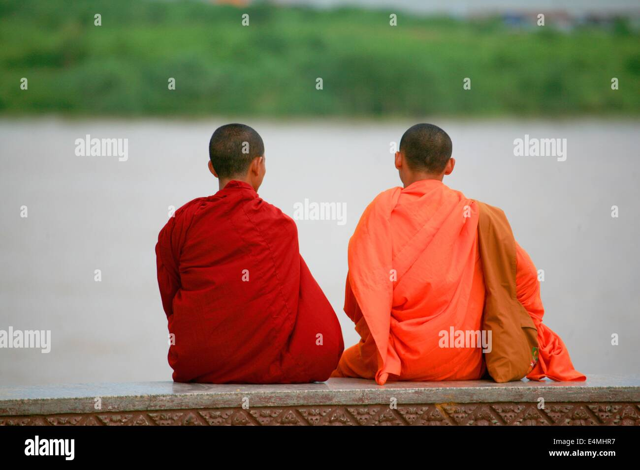 Buddhist monks in orange robes in Cambodia Stock Photo