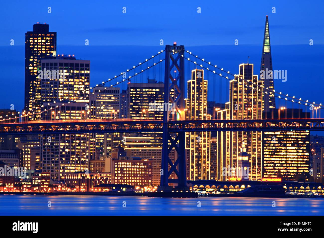 San Francisco City Skyline With Holiday Lights On At Night And The Bay  Bridge Nice Look