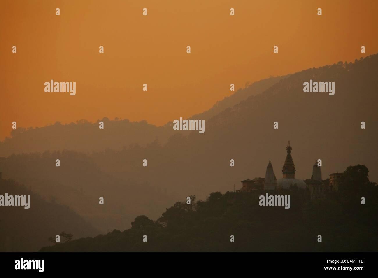 Swayambunath monkey temple in Kathmandu Nepal at sunset - Stock Image