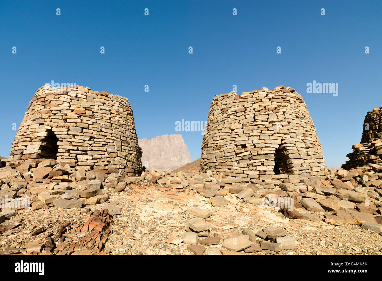 Beehive tombs, a UNESCO World Heritage site. Located at Al-Ayn in the Hajar Mountains of Oman in the MIddle East. - Stock Image