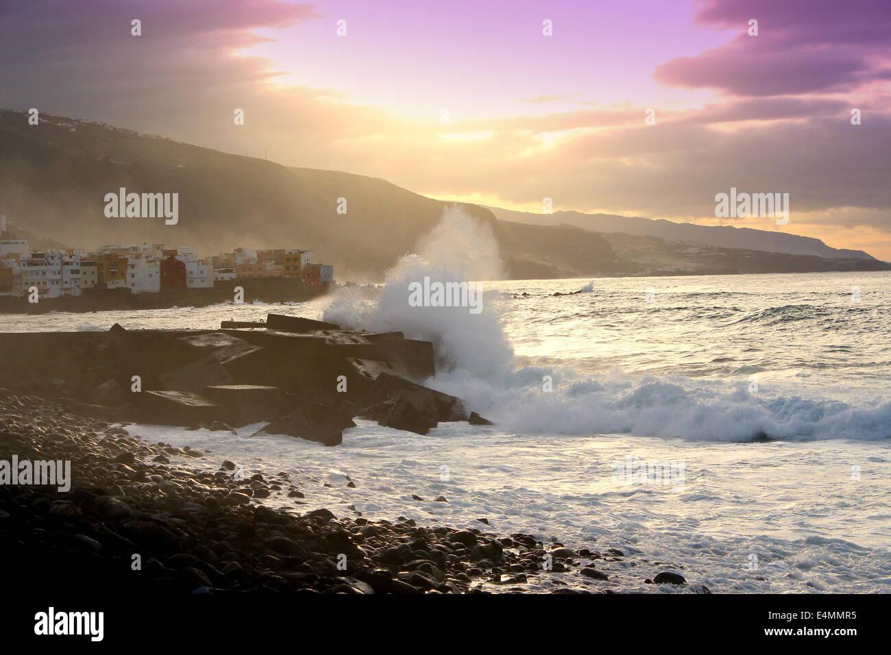 Pounding surf and meters high waves on the Atlantic Ocean coast of Puerto de la Cruz, Tenerife, Spain at sunset, - Stock Image