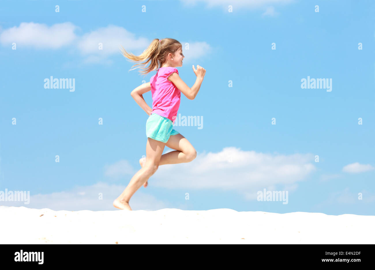 little girl running in sand stock photo 71763035 alamy