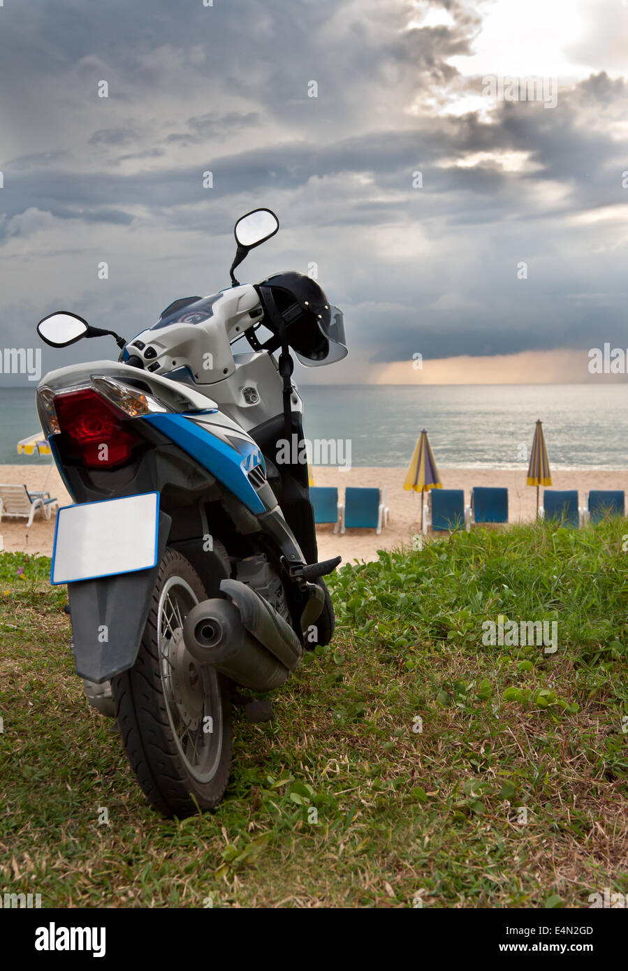 motorcycle on Karon Beach Phuket - Stock Image