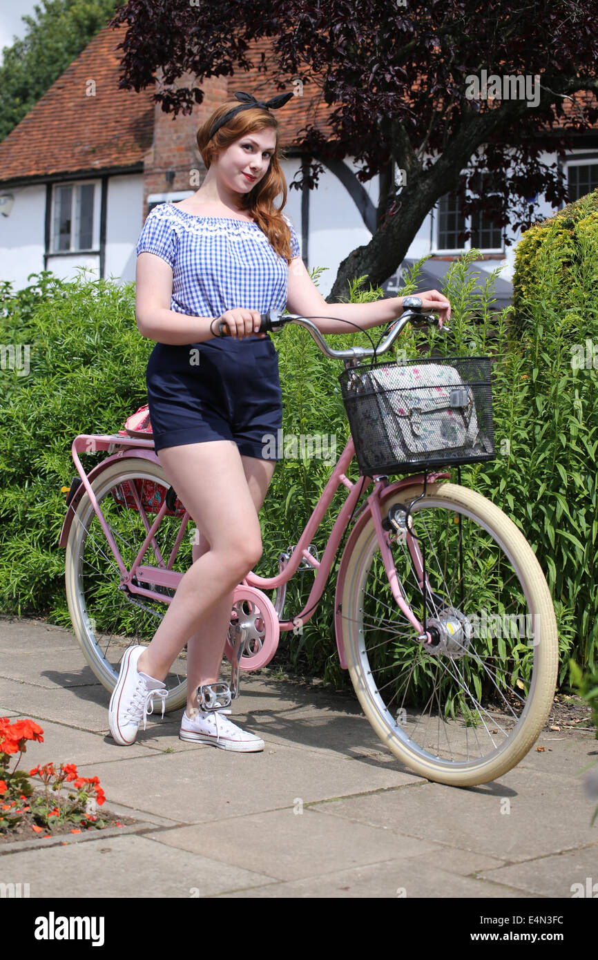 Girl with vintage style bicycle - Stock Image