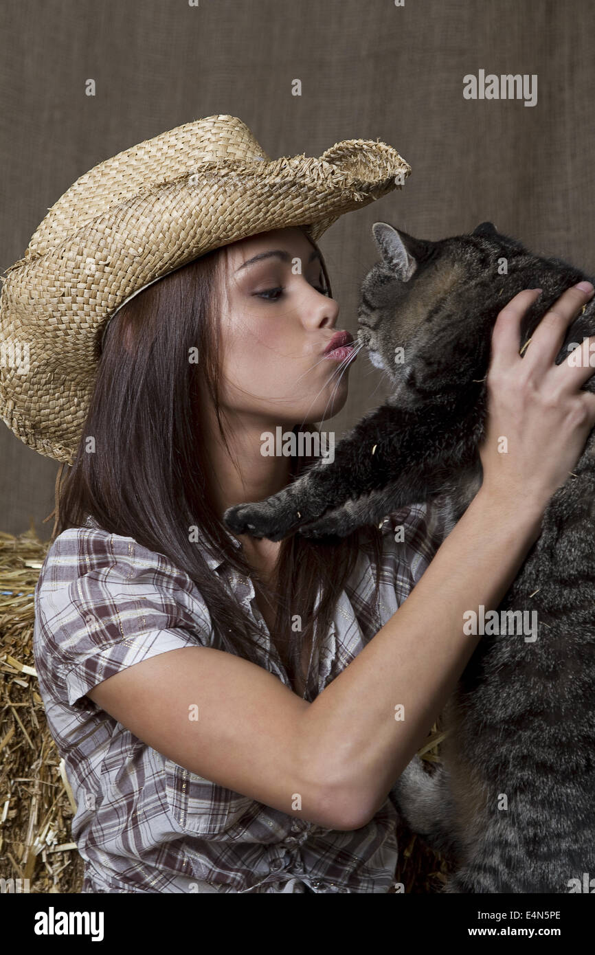 Cowgirl kissing cat Stock Photo   Alamy