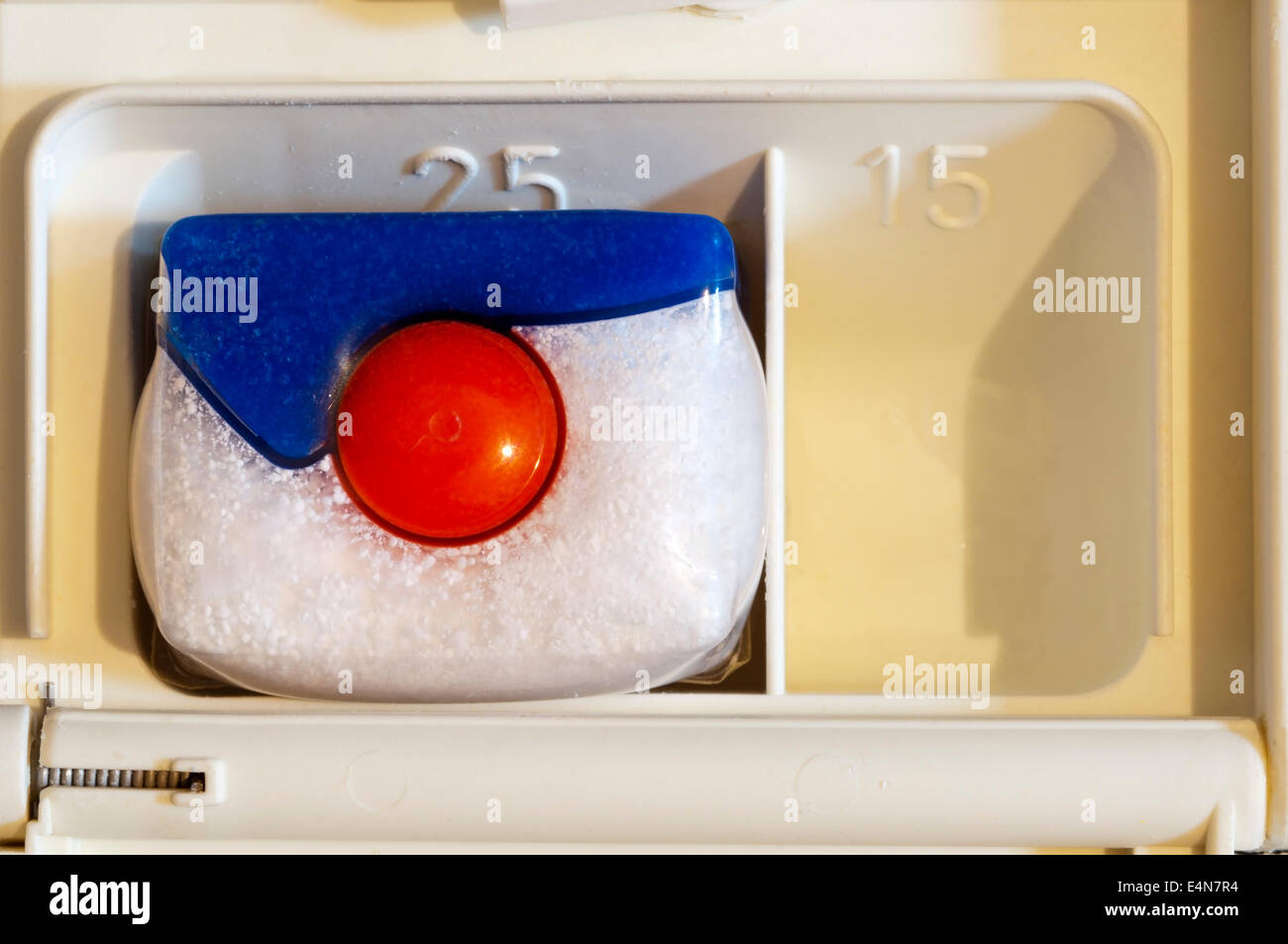 Finish Powerball Quantum Power Gel dishwasher tablet in soap compartment of dishwasher. - Stock Image