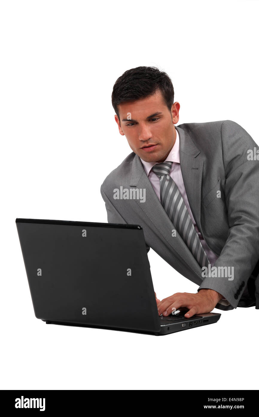 Elegant man with a computer - Stock Image