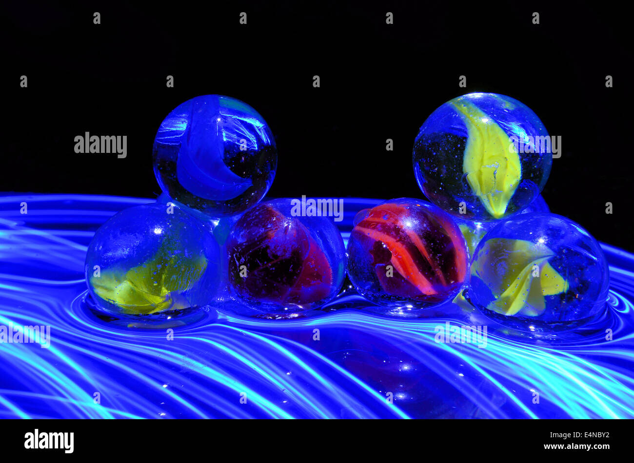 colored  marbles with different lighting effects - Stock Image