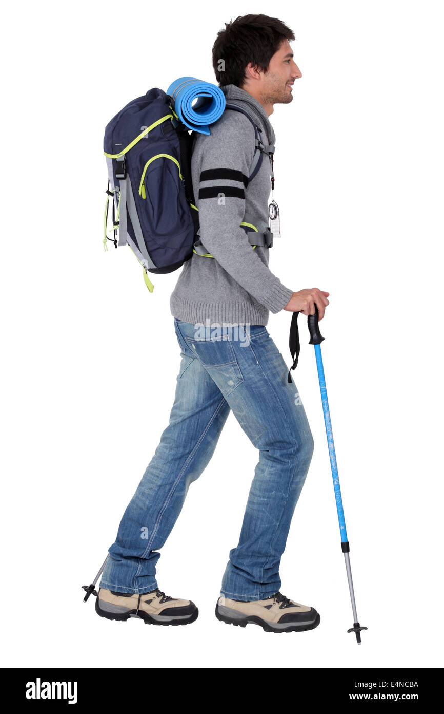 a man ready for backpacking in mountains - Stock Image