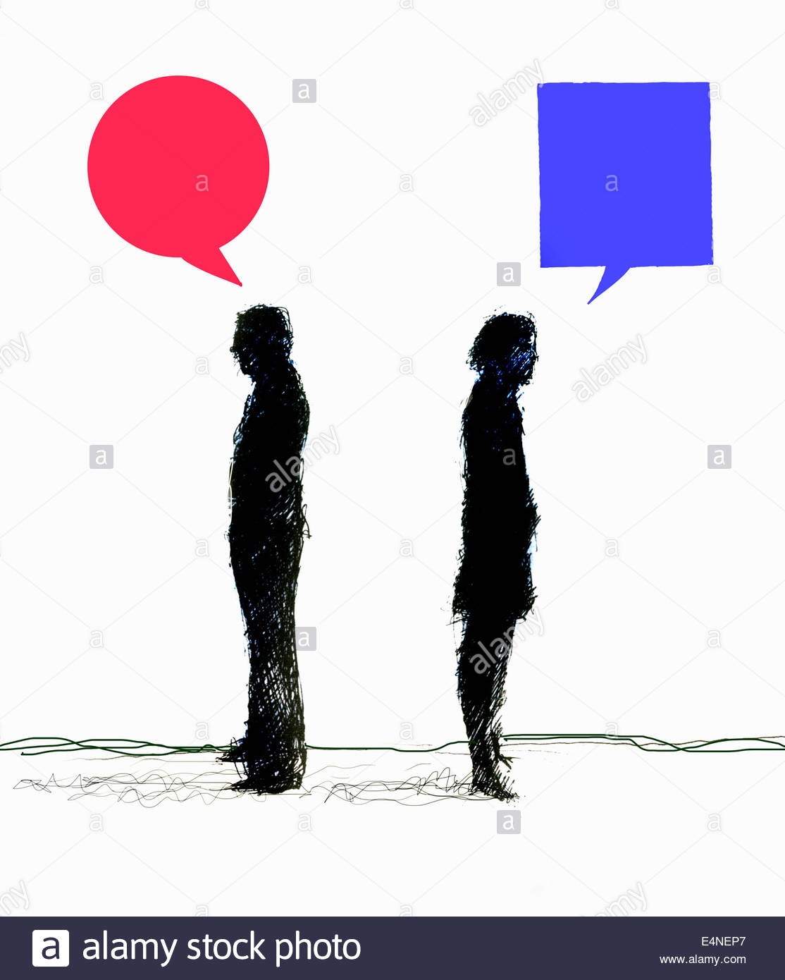 Opposed businessman and businesswoman standing back to back communicating with contrasting speech bubbles - Stock Image