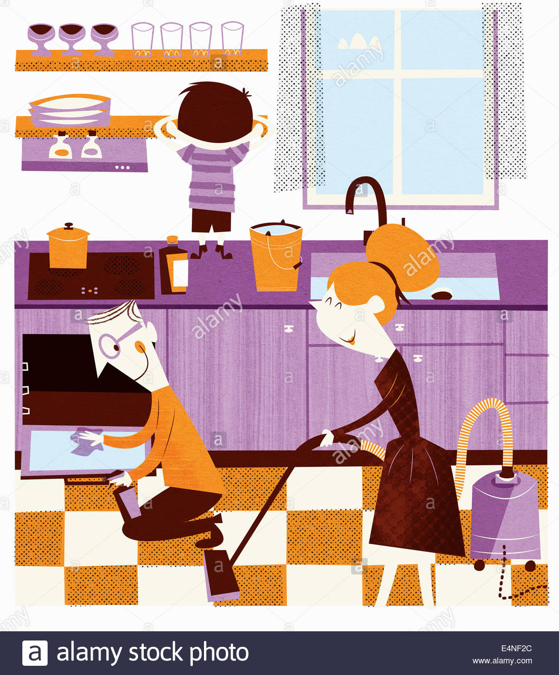 Happy family working together in kitchen to spring clean home - Stock Image
