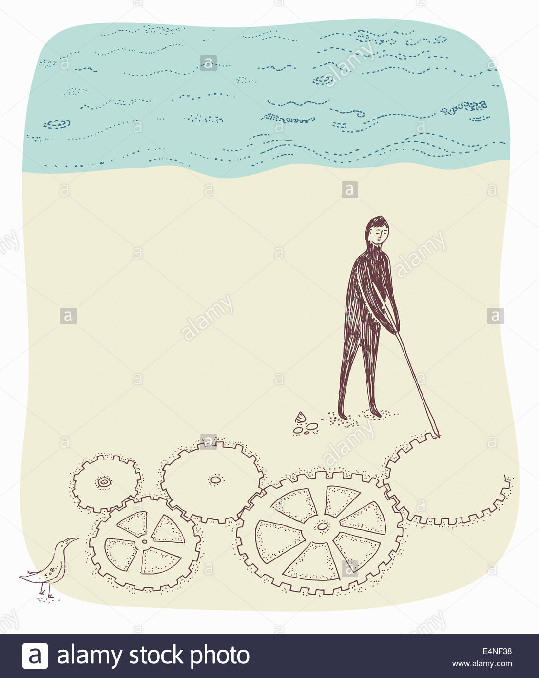 Man drawing connected cogs in sand on beach - Stock Image