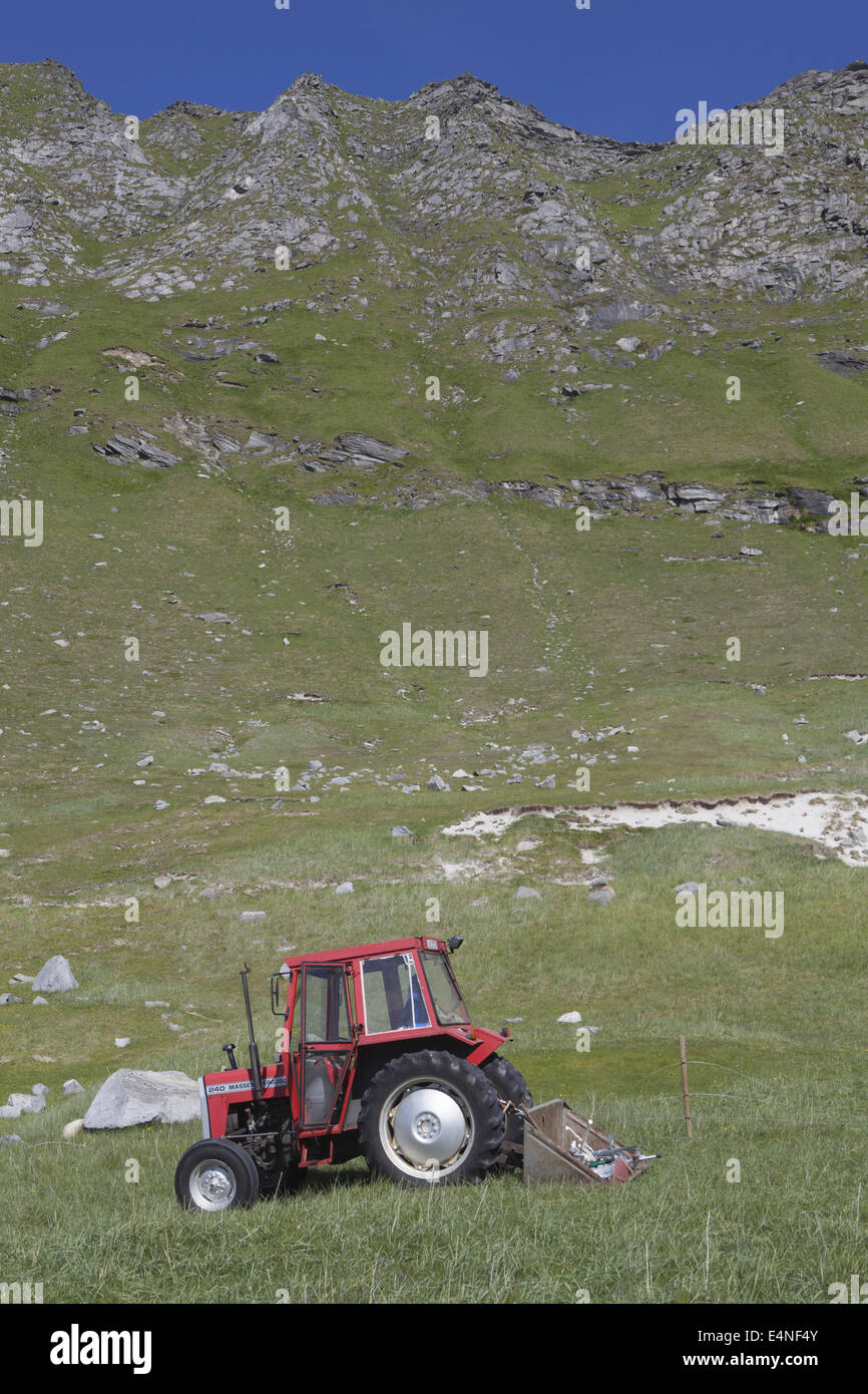 Tractor on the beach of Haukland, Norway - Stock Image