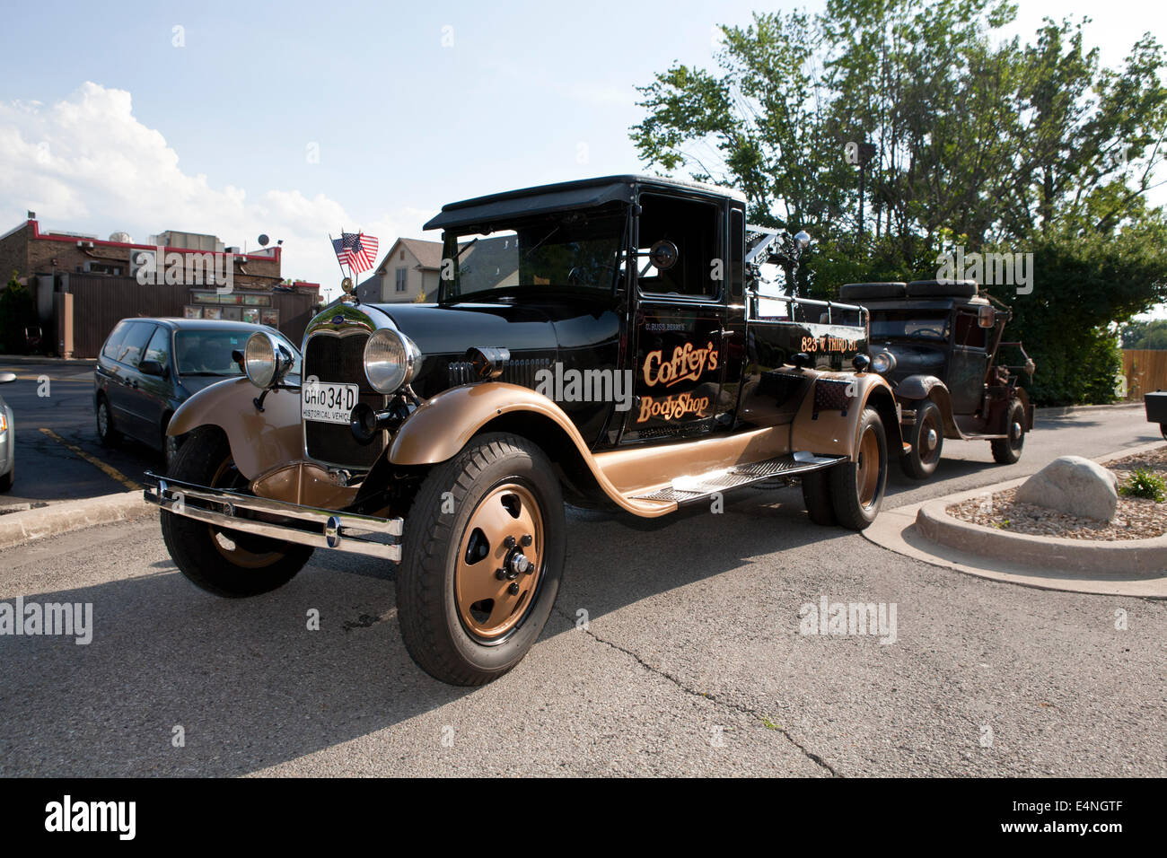Old, restored tow truck towing an old, beat up tow truck Stock Photo ...
