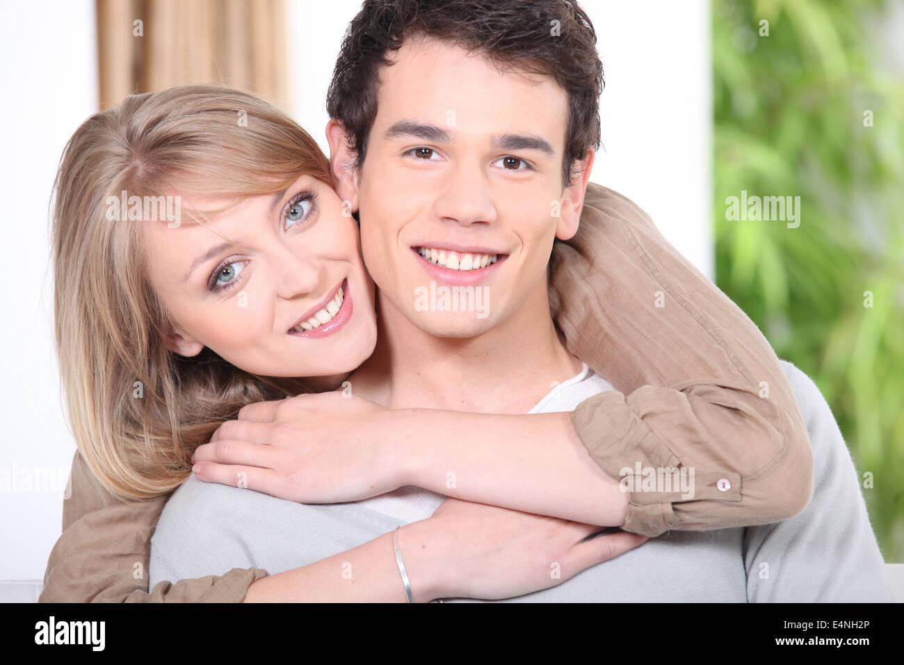 Woman embracing her boyfriend - Stock Image