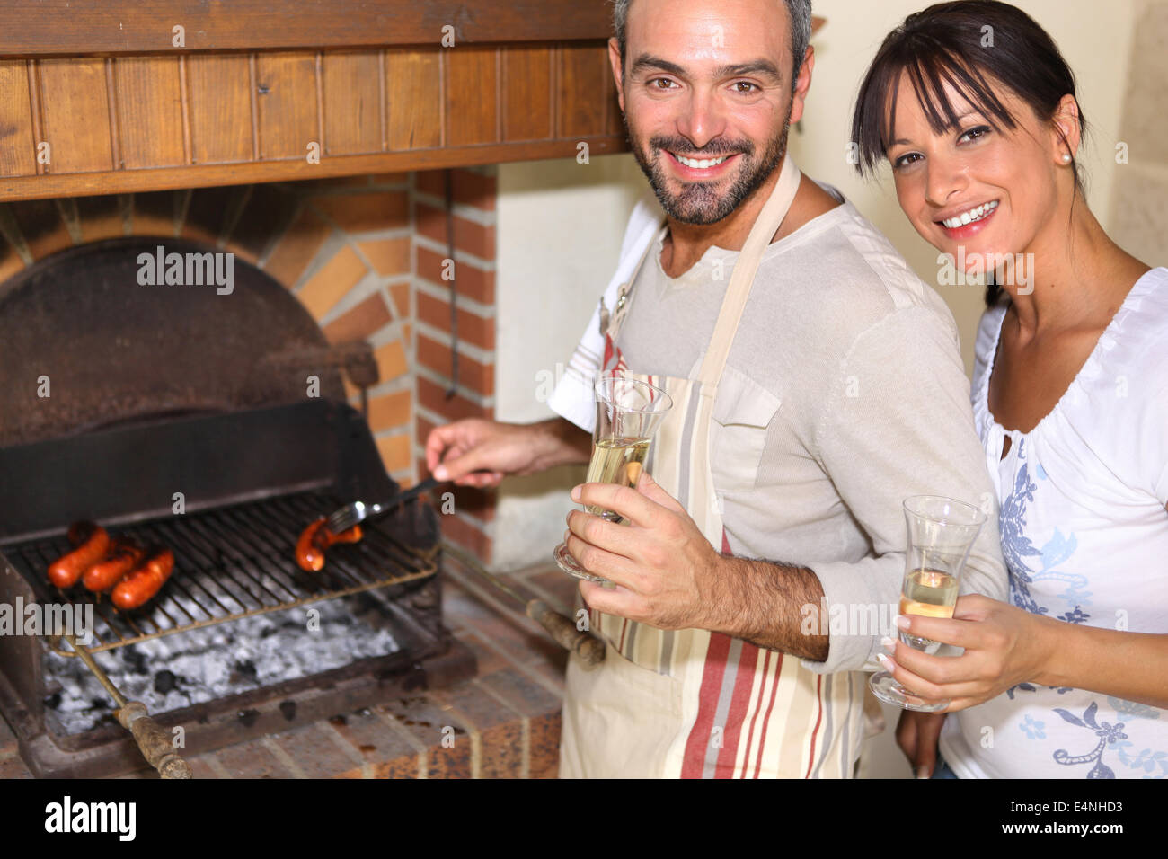 couple having nice time near the fireplace - Stock Image