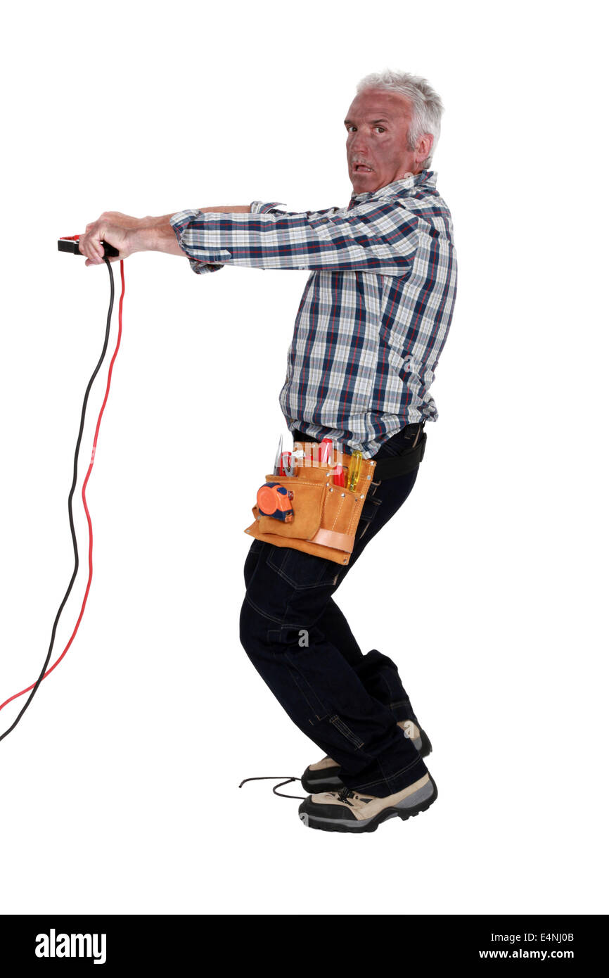Electrocuted man holding jumper cables Stock Photo: 71775211 - Alamy