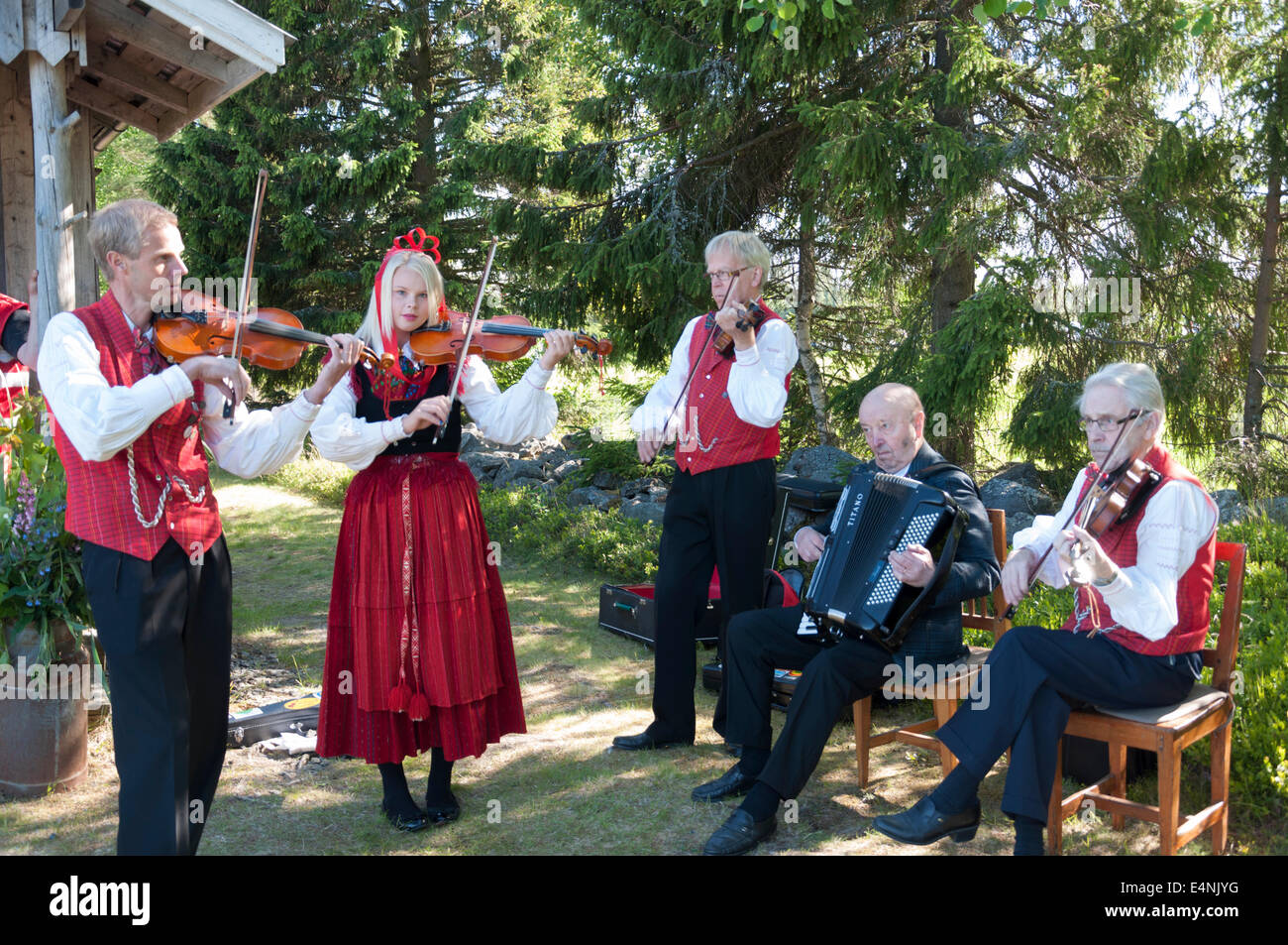 Folk music musician's playing at a birthday party. - Stock Image