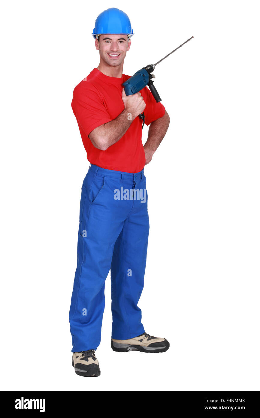 a worker holding a power drill - Stock Image