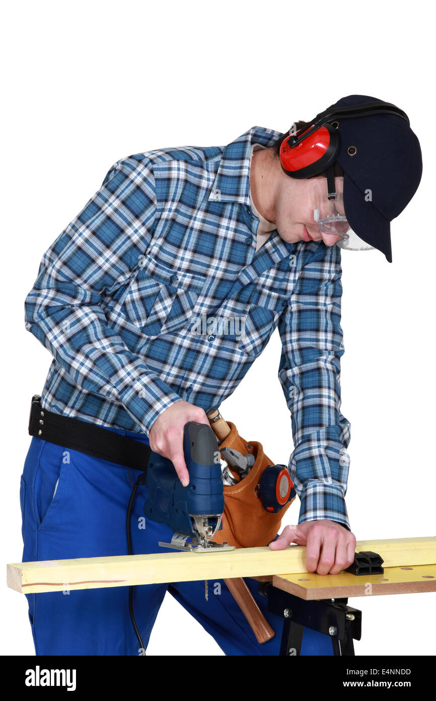 Woodworker using jigsaw - Stock Image