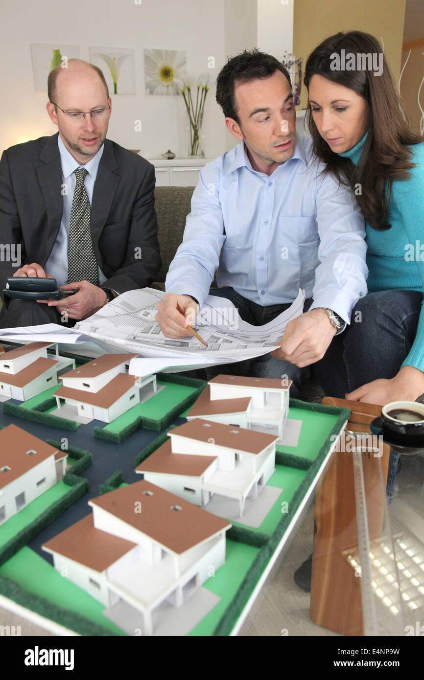 Couple looking at a new build - Stock Image