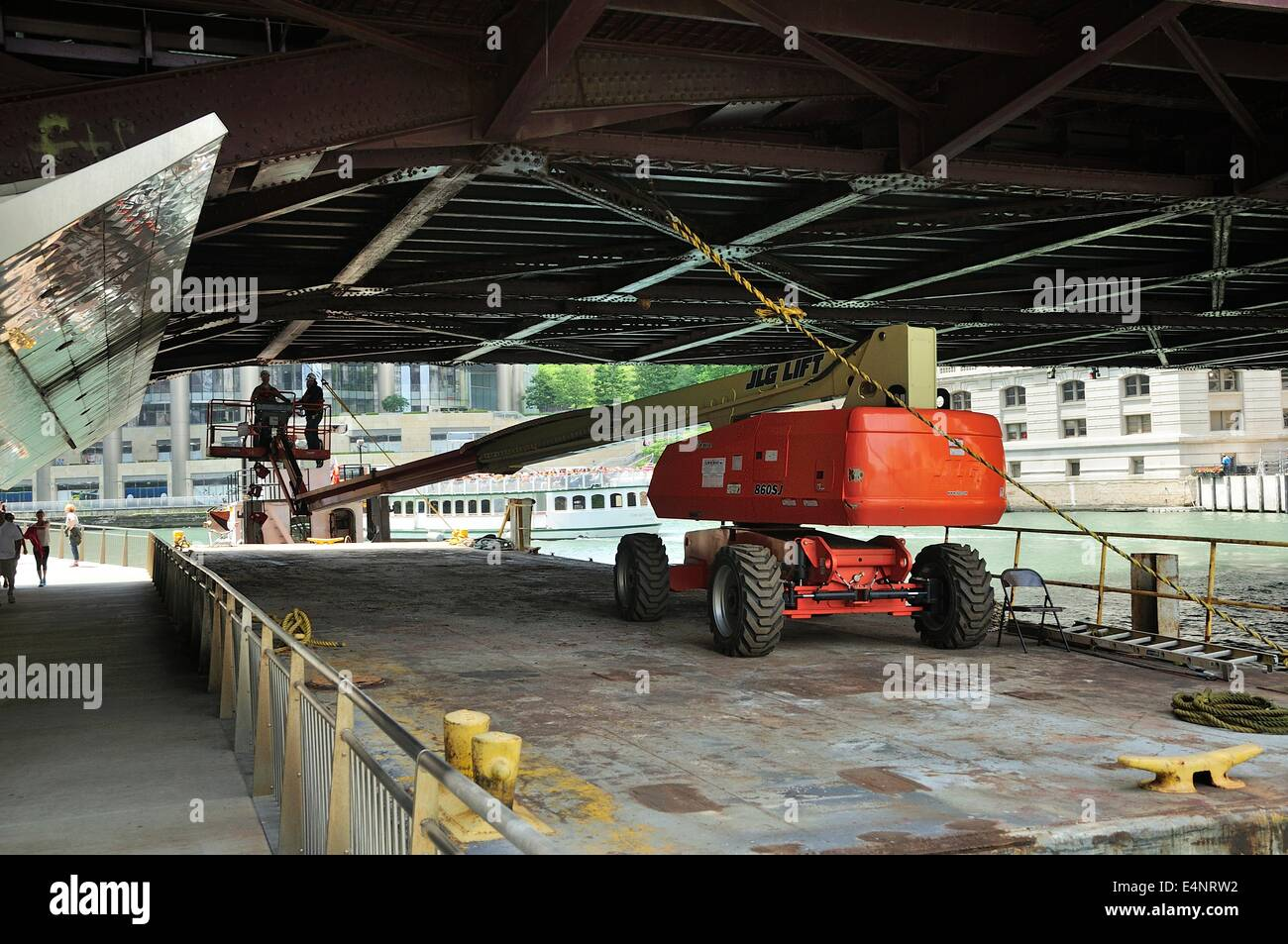 Construction workers repairing a Chicago River bridge. - Stock Image