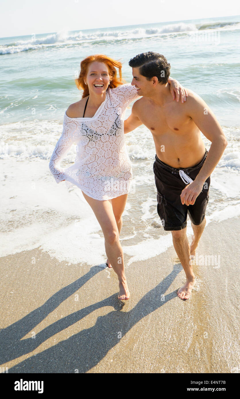 USA, Florida, Palm Beach, Portrait of couple on beach - Stock Image